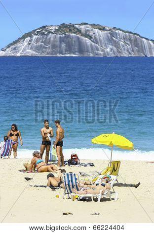 Rio De Janeiro, Brazil - August 29, 2008: Copacabana Beach In Summer Day, Sunbathers Enjoying The Da