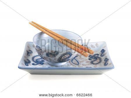 empty bowl, dish and chopsticks