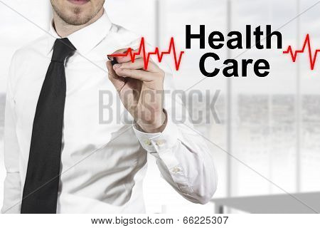 doctor drawing heartbeat line healthcare