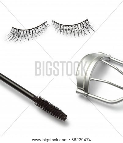 fake false eyelash with eyelash curler and mascara on white