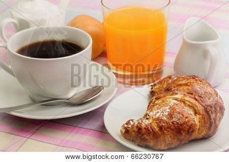 breakfast with croissants and cappuccino