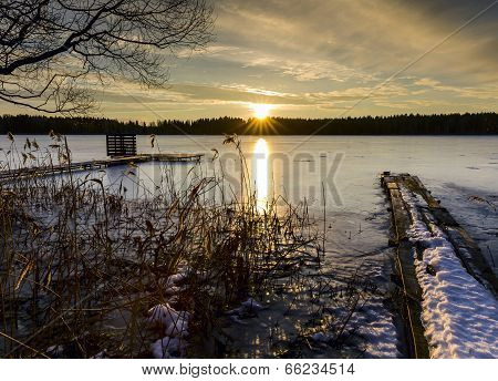 Sunset In Winter Evening Near A Frozen Lake