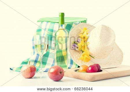 picnic backet with food and wine