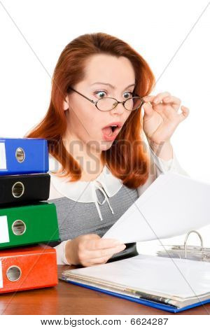 shoked business woman in glasses looking at the paper