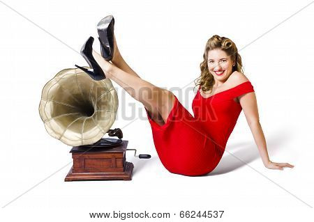 Pinup Girl In Red Dress Playing Classical Music
