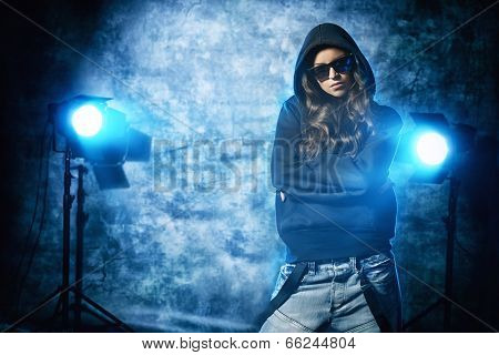Modern hip-hop dancer over grunge background.