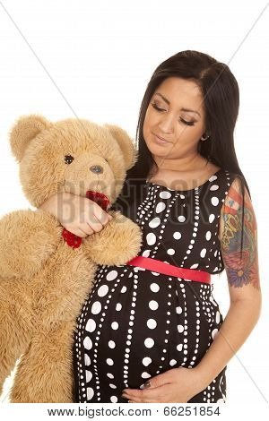 Pregnant Woman Dot Dress Bear Look Down