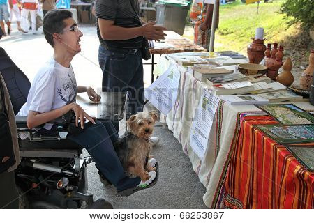 Marseille, France - August 26: Photo Of A Young Man In A Wheelchair With His Pet. Marseille Festival