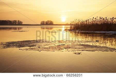 Winter Landscape With River, Reeds And Sunset Sky. Beautiful Winter Landscape. Composition Of Nature