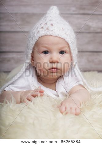Adorable  baby boy in white hat