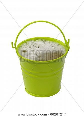 Green Bucket With Foaming Liquid.isolated.