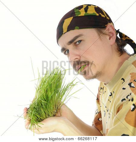 Young Man Eating Grass