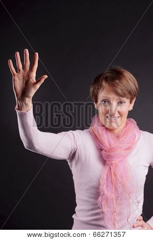 Mature Woman With A Raised Hand