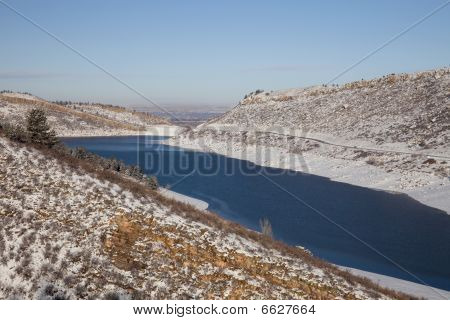 Mountain Reservoir In Winter Scenery