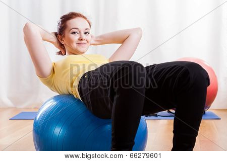 Girl Doing Crunches On Gym Ball