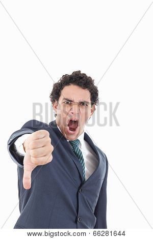 Disappointed Young Businessman Showing Thumb Down Sign