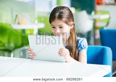 Little Smiling Girl With Apple Ipad Air