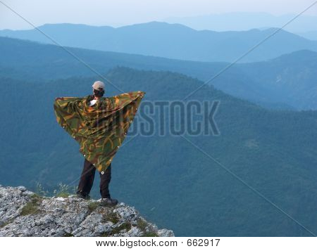 Man standing on the edge of the mountain