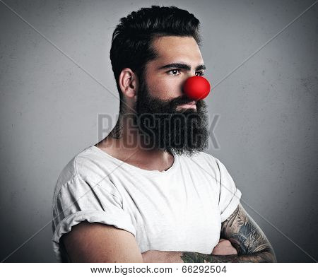 Brutal bearded man with funny red nose