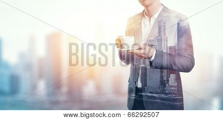 Double exposure of city and business man with cup of coffee