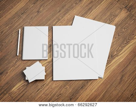 Blank stationery set on wood background