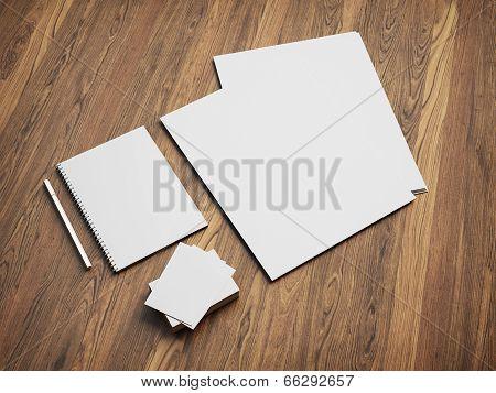 Blank stationery set on wood background