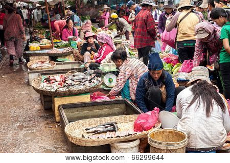 People at traditional asian food marketplace, Siem Reap Cambodia.