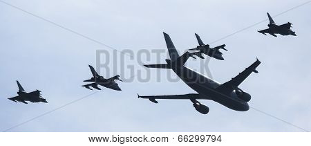 BERLIN, GERMANY - MAY 21, 2014: Airbus A310-304 is used as a tanker and fly 2 Tornado in refueling position, 2 outside flying Eurofighter are in waiting position, demonstration at ILA Berlin Air Show.