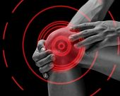 stock photo of joint  - Pain in the male knee joint pain area of red color - JPG