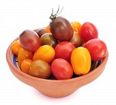 picture of plum tomato  - an earthenware bowl with baby plum tomatoes of different colors on a white background - JPG