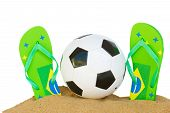 stock photo of brasilia  - football ball in sand with sandals in brasilia colors isolated on white background border - JPG