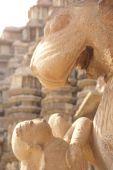 stock photo of kandariya mahadeva temple  - Lion and young woman statues at Kandariya Mahadeva Temple at Khajuraho in India Asia - JPG