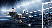 stock photo of hispanic  - Hispanic Soccer Player kicking the ball - JPG