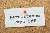 image of persistence  - The phrase Persistence Pays Off typed on a paper note and pinned to a cork notice board