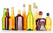 stock photo of ethanol  - Bottles of assorted alcoholic beverages isolated on white background - JPG