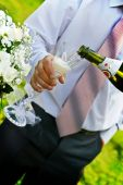 foto of champa  - Man with necktie pouring champagne to wineglass - JPG