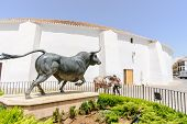 stock photo of bullfighting  - Bullfighting arena with monument in  Ronda - JPG