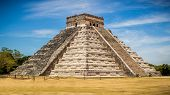 stock photo of depreciation  - A different view of Chichen Itza It shows the actual side depreciated from vine growth - JPG