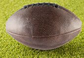 picture of pro-life  - Leather football over a green grass field - JPG