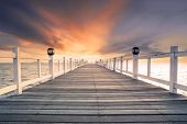 stock photo of sea-scape  - old wood bridg pier with nobody against beautiful dusky sky use for natural background backdrop and multipurpose sea scene - JPG