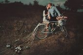foto of night gown  - Groom and bride on a bicycle with just married sign and cans attached - JPG