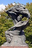 stock photo of chopin  - Monument Frederic Chopin seeking inspiration under a willow tree in Warsaw Poland - JPG