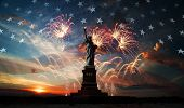 stock photo of usa flag  - Statue of Liberty on the background of flag usa sunrise and fireworks - JPG