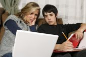 Teenagers Doing Homework With Laptop