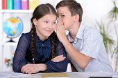 picture of pre-adolescent child  - Portrait of a school child making learning during lesson at school - JPG