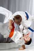 foto of judo  - Training judo throw sportsman in judogi and with blue belt - JPG