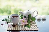 stock photo of wild-brier  - Cup of herbal tea with wild rose - JPG