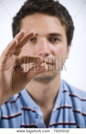 Close Up Man Showing Pill