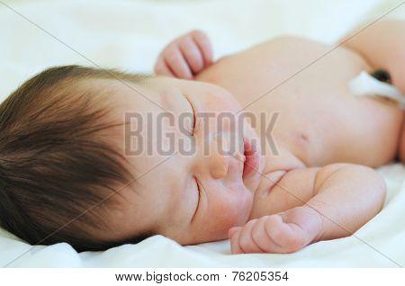 Baby With Umbilical Cord Sleeping