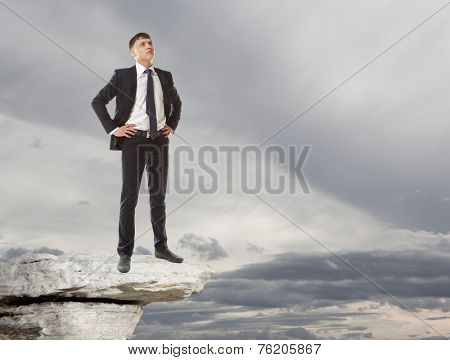 Businessman standing on a peak  Business concept